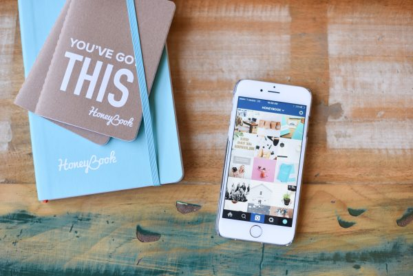 HoneyBook Doula Business planner and Smartphone with Instagram Grid Display